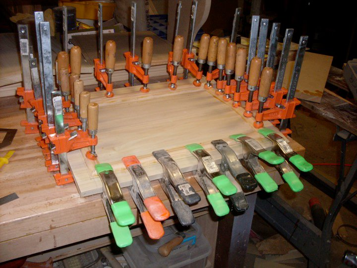 Applying moulding to curved cabinet door. Got clamps?