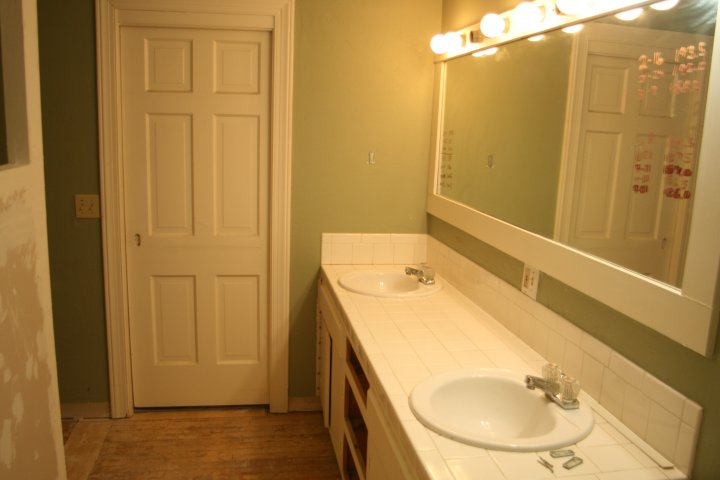 Original vanity and mirror in place