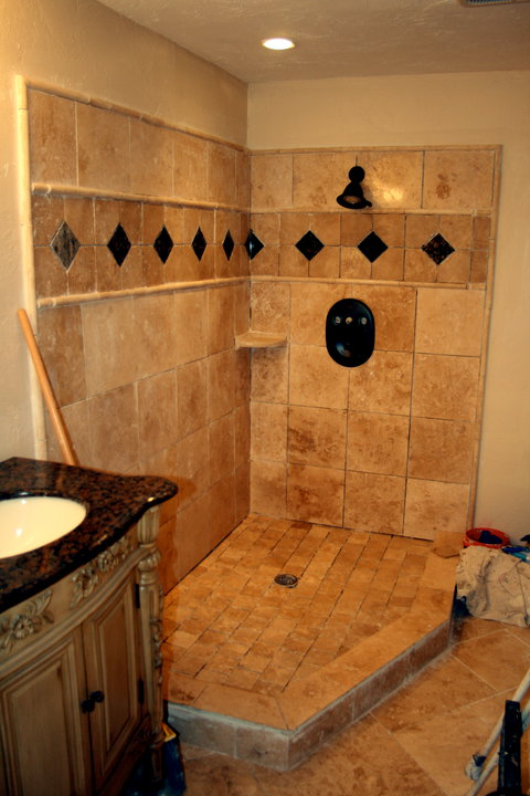 Shower tile installed (no grout yet).