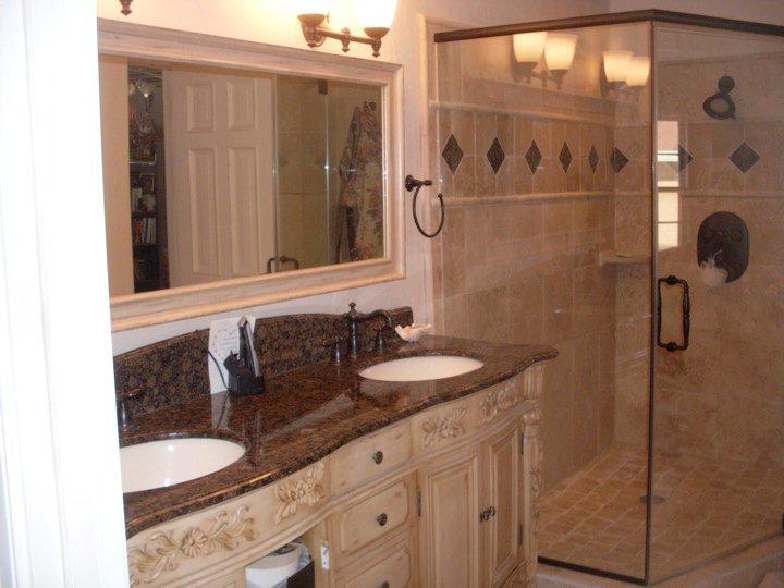 Custom made vanity backsplash and a framed mirror have been added.