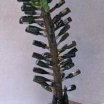 Miniature bottles turned on lathe and hand painted. Tree is 8 inches high.